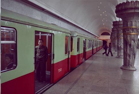 North Korea Travel: Man watches on Pyongyang Metro as door closes